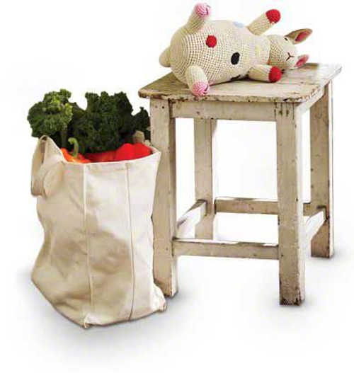 stool with stuffed toy cow and bag of groceries